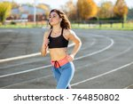 woman running on the track... | Shutterstock . vector #764850802