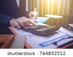 man using calculator and... | Shutterstock . vector #764852512