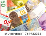 swiss franc bills and coins 1 ... | Shutterstock . vector #764933386