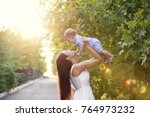 beautiful young mother holding... | Shutterstock . vector #764973232