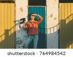 young girl stands near colorful ...   Shutterstock . vector #764984542