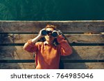 young girl lies on a pier near... | Shutterstock . vector #764985046