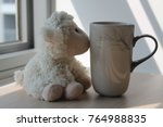 Lamb Toy With Cup Sitting By...