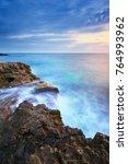 beautiful seascape sunset.... | Shutterstock . vector #764993962