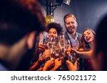 group of friends celebrating... | Shutterstock . vector #765021172