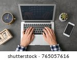 man using laptop on table  top... | Shutterstock . vector #765057616