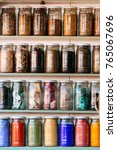colorful jars at shelf | Shutterstock . vector #765067696