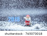 little red santa claus doll and ... | Shutterstock . vector #765073018