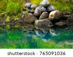 Rocks Along A Riverbank Cast...