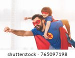 father and son in the red and... | Shutterstock . vector #765097198