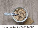 muesli   porcelain spoon and... | Shutterstock . vector #765116806