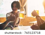 friends toasting with glasses... | Shutterstock . vector #765123718