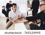 a man in a white t shirt is...   Shutterstock . vector #765124945