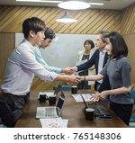 business people shaking hands ... | Shutterstock . vector #765148306