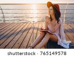 sexy slim woman sitting at sea... | Shutterstock . vector #765149578