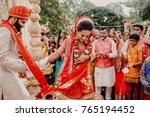 indian groom dressed in white... | Shutterstock . vector #765194452