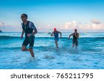triathletes running out of the... | Shutterstock . vector #765211795