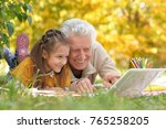 girl  and grandfather with ... | Shutterstock . vector #765258205