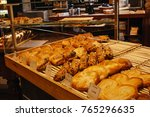 french pastries display into a... | Shutterstock . vector #765296635