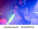 dj playing music on smoke and... | Shutterstock . vector #765304912