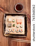 sushi set on pottery plate with ...   Shutterstock . vector #765368362