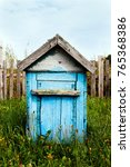 old wooden hive painted in blue ...   Shutterstock . vector #765368386