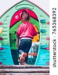 little toddler girl playing in...   Shutterstock . vector #765368392