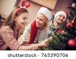happy young family decorating... | Shutterstock . vector #765390706