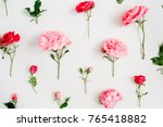 Stock photo floral pattern made of pink and red roses green leaves branches on white background flat lay 765418882