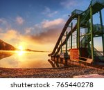 sunset shore and toboggan... | Shutterstock . vector #765440278