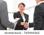 businesswoman shaking hands... | Shutterstock . vector #765444262