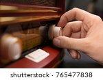 person tuning retro radio ... | Shutterstock . vector #765477838