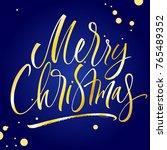 merry christmas lettering on... | Shutterstock .eps vector #765489352