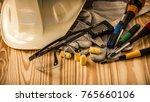 white safety helmet  glove  eye ... | Shutterstock . vector #765660106