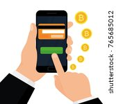 crypto currency concept. hand... | Shutterstock .eps vector #765685012