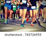women and men runners with...   Shutterstock . vector #765726955