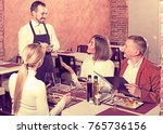young man waiter receiving...   Shutterstock . vector #765736156