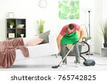 Young Man Cleaning Floor With...