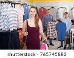 smiling wife shopping bags with ... | Shutterstock . vector #765745882