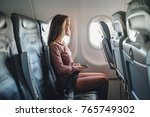 girl is strapped on the plane... | Shutterstock . vector #765749302