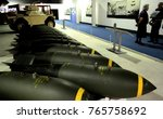 Small photo of Royal Air Force Museum, London, UK. Daimler Ferret AFV in background - 10/27/15: Bombs displayed beneath Avro Vulcan in Bomber Hall.