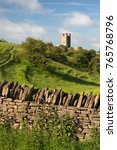 Small photo of BROADWAY, COTSWOLD DISTRICT, WORCESTERSHIRE, ENGLAND - JUNE 05, 2107: Broadway Tower and dry stone wall