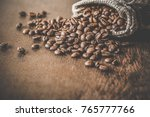 brown beans with burlap bag on...   Shutterstock . vector #765777766