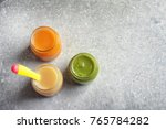 jars with healthy baby food on... | Shutterstock . vector #765784282