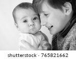 big brother hold her baby... | Shutterstock . vector #765821662