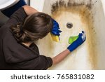 tired housewife cleaning old...   Shutterstock . vector #765831082