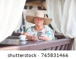 an eldery woman sitting in the... | Shutterstock . vector #765831466