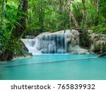 deep forest waterfall in... | Shutterstock . vector #765839932