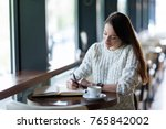 young attractive woman writing... | Shutterstock . vector #765842002