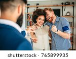 young couple buying their new... | Shutterstock . vector #765899935
